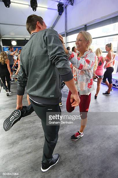 Tomas Berdych of the Czech Republic and Caroline Wozniacki of Denmark stretch during the adidas ACE Case Launch at Crown Entertainment Complex on...