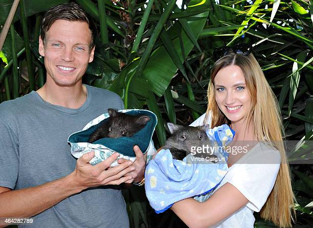 Tomas Berdych of the Czech Republic and girlfriend Ester Satorova pose with Wombats at the player cafe during day 10 of the 2014 Australian Open at...