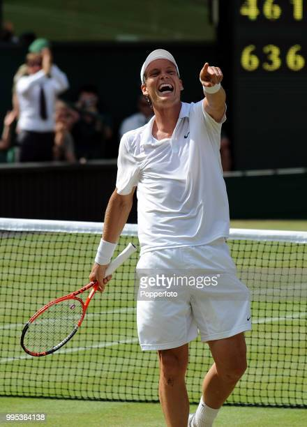 Tomas Berdych of the Czech Republic celebrates after beating Roger Federer of Switzerland in the Mens Singles Quarter Final on day nine of the 2010...