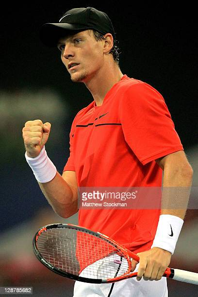 Tomas Berdych of the Czech Republic celebrates breaking JoWilfried Tsonga of France in the third set during the semifinals of the China Open at the...
