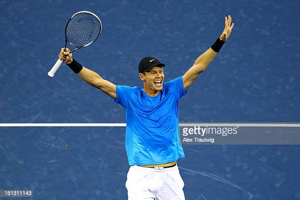 Tomas Berdych of the Czech Republic celebrates defeating Roger Federer of Switzerland after their men's singles quarterfinal match on Day Ten of the...