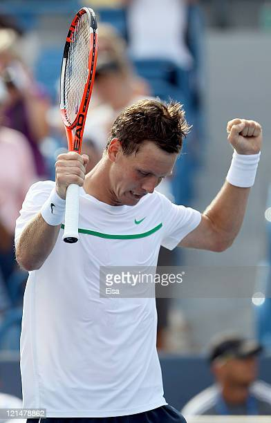 Tomas Berdych of the Czech Republic celebrates his match win over Roger Federer of Switzerland during the Western Southern Open at the Lindner Family...