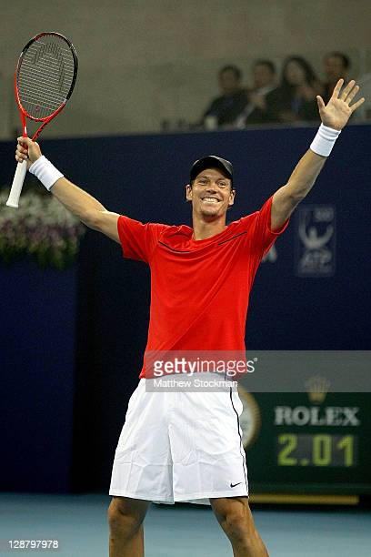 Tomas Berdych of the Czech Republic celebrates match point against Marin Cilic of Croatia during the final of the China Open at the National Tennis...