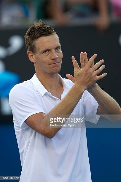 Tomas Berdych of the Czech Republic celebrates victory in his fourth round match against Kevin Anderson of South Africa during day seven of the 2013...