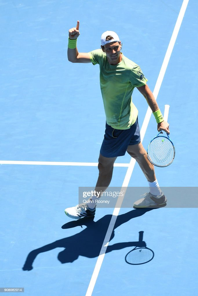 Tomas Berdych of the Czech Republic celebrates winning match point in his fourth round match against Fabio Fognini of Italy on day eight of the 2018 Australian Open at Melbourne Park on January 22, 2018 in Melbourne, Australia.
