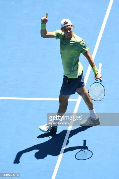 Tomas Berdych of the Czech Republic celebrates winning match point in his fourth round match against Fabio Fognini of Italy on day eight of the 2018...