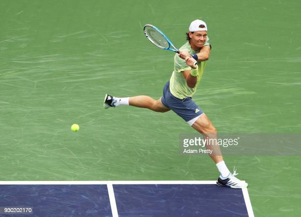 Tomas Berdych of the Czech Republic hits a backhand during his match against Maximilian Marterer of Germany during the BNP Paribas Open at the Indian...
