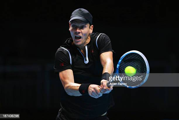 Tomas Berdych of the Czech Republic hits a backhand in his men's singles match against Rafael Nadal of Spain during day five of the Barclays ATP...