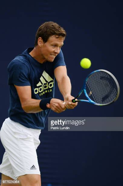 Tomas Berdych of the Czech Republic hits a backhand in practice during qualifying Day 2 of the FeverTree Championships at Queens Club on June 17 2018...