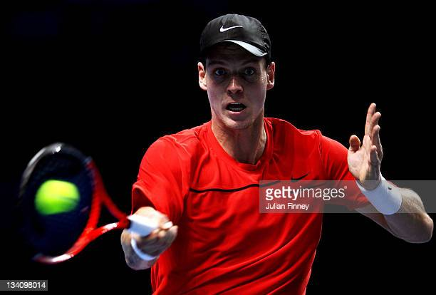 Tomas Berdych of the Czech Republic hits a forehand during the men's singles match against David Ferrer of Spain during the Barclays ATP World Tour...