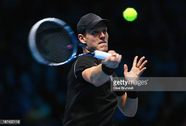 Tomas Berdych of the Czech Republic hits a forehand in his men's singles match against Rafael Nadal of Spain during day five of the Barclays ATP...