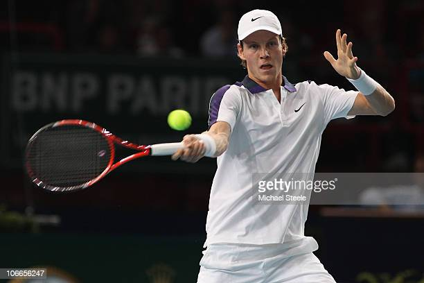 Tomas Berdych of the Czech Republic in action against Florent Serra of France during Day Three of the ATP Masters Series Paris at the Palais...