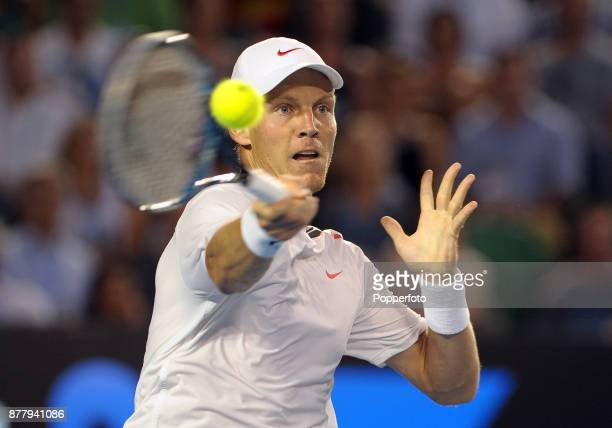 Tomas Berdych of the Czech Republic in action against Rafa Nadal of Spain during the Men's Singles quarter final on day nine of the 2012 Australian...