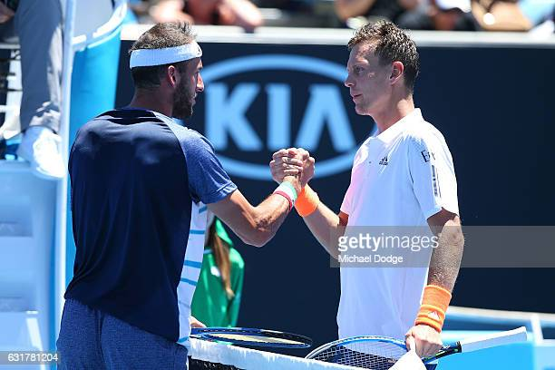 Tomas Berdych of the Czech Republic is congratulatged by Luca Vanni of Italy after their first round match on day one of the 2017 Australian Open at...