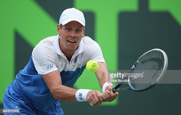 Tomas Berdych of the Czech Republic plays a backhand against Alexandr Dolgopolov of the Ukraine during their quarter final round match during day 11...