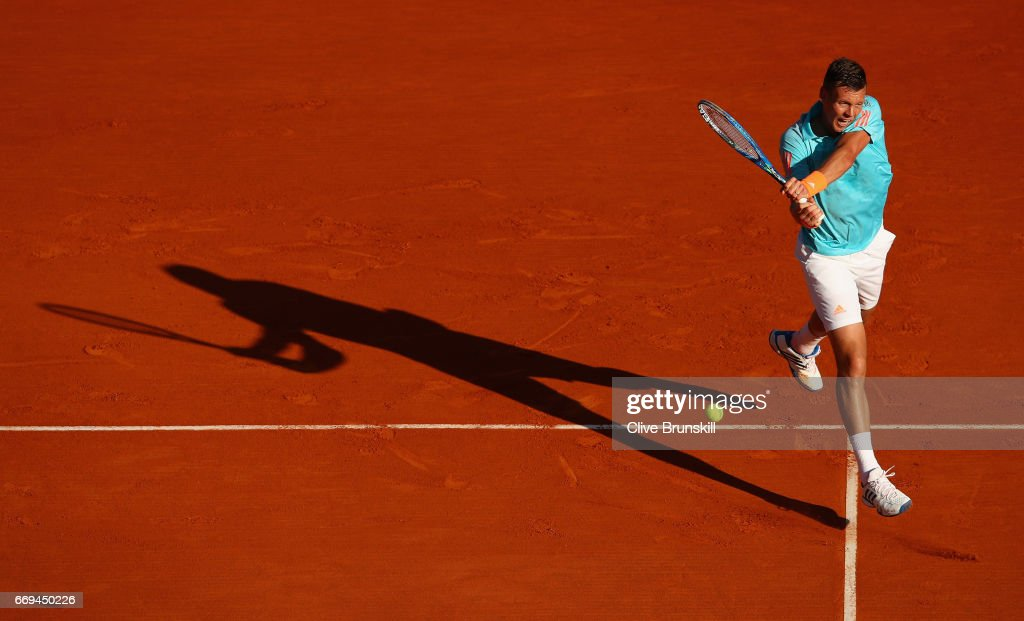 Tomas Berdych of the Czech Republic plays a backhand against Andrey Kuznetsov of Russia in their first round match on day two of the Monte Carlo Rolex Masters at Monte-Carlo Sporting Club on April 17, 2017 in Monte-Carlo, Monaco.