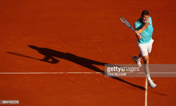 Tomas Berdych of the Czech Republic plays a backhand against Andrey Kuznetsov of Russia in their first round match on day two of the Monte Carlo...