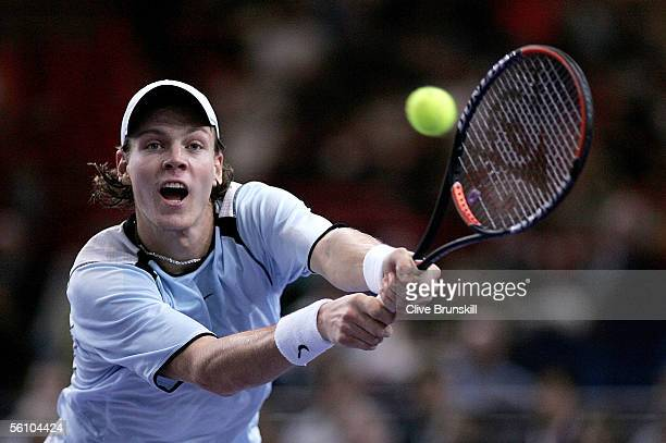 Tomas Berdych of the Czech Republic plays a backhand against Ivan Ljubicic of Croatia in the final of the BNP Paribas ATP Masters Series on November...