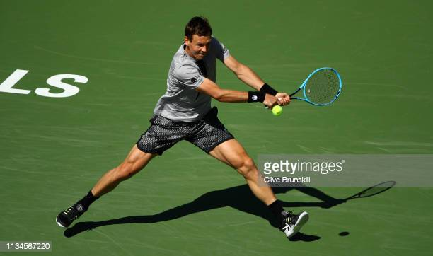 Tomas Berdych of the Czech Republic plays a backhand against Feliciano Lopez of Spain during their men's singles first round match on day five of the...