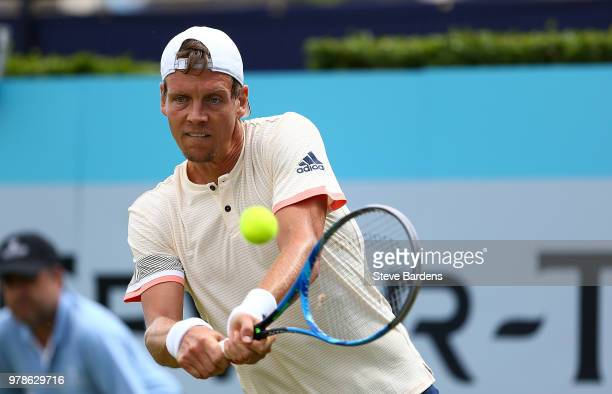 Tomas Berdych of The Czech Republic plays a backhand during his match against Julien Benneteau of France on Day Two of the FeverTree Championships at...