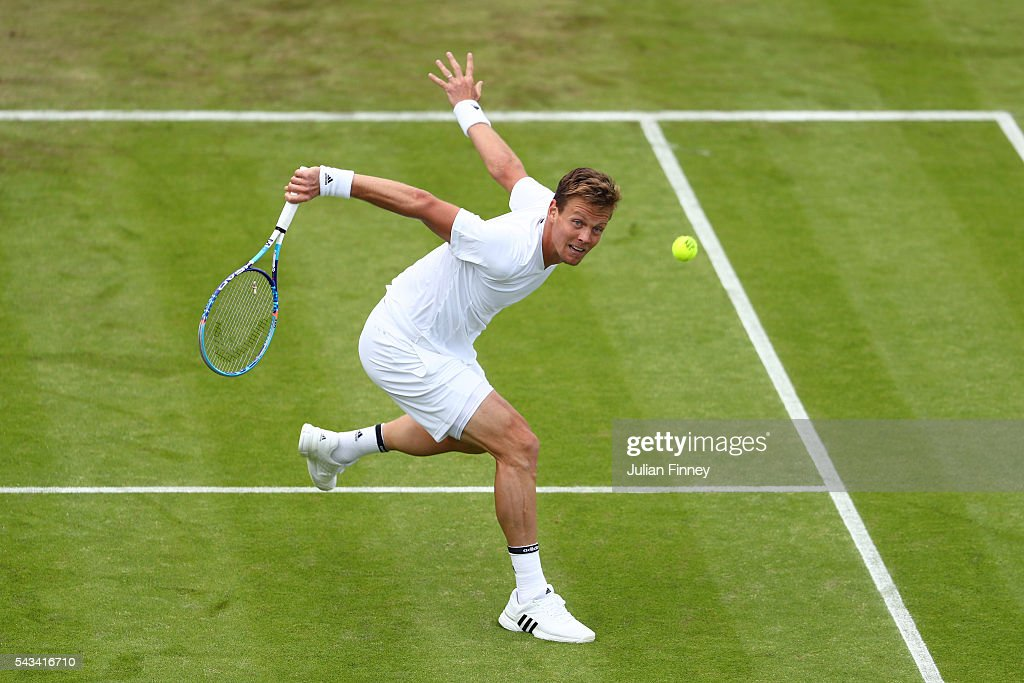 Tomas Berdych of The Czech republic plays a backhand during the Men's Singles first round match against Ivan Dodig of Croatia on day two of the Wimbledon Lawn Tennis Championships at the All England Lawn Tennis and Croquet Club on June 28, 2016 in London, England.
