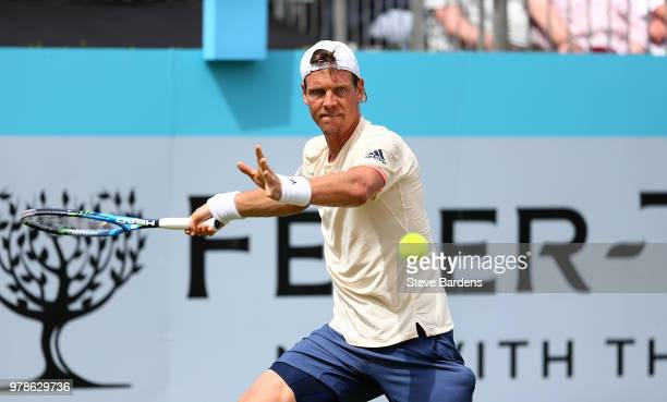 Tomas Berdych of The Czech Republic plays a forehand during his match against Julien Benneteau of France on Day Two of the FeverTree Championships at...