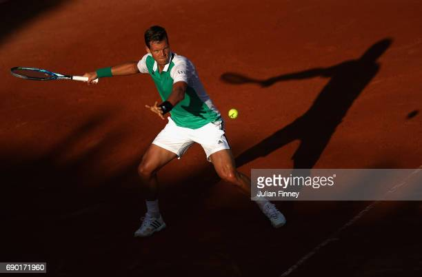 Tomas Berdych of The Czech Republic plays a forehand during the mens singles first round match against JanLennard Struff of Germany on day three of...