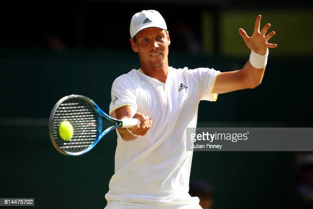 Tomas Berdych of The Czech Republic plays a forehand during the Gentlemen's Singles semi final match against Roger Federer of Switzerland on day...