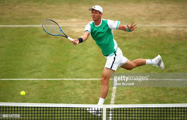 Tomas Berdych of The Czech Republic plays a volley during the mens singles quarter final match against Feliciano Lopez of Spain on day five of the...