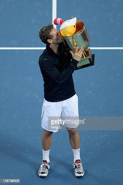 Tomas Berdych of the Czech Republic pose for photographers after winning the men's final of the China Open at the National Tennis Center on October...