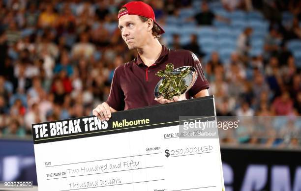 Tomas Berdych of the Czech Republic poses with the trophy and the winners cheque after winning the Tie Break Tens ahead of the 2018 Australian Open...