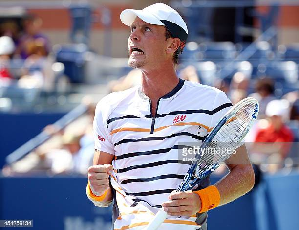 Tomas Berdych of the Czech Republic reacts after winning the first set against Lleyton Hewitt of Australia during their men's singles first round...