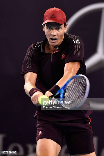 Tomas Berdych of the Czech Republic returns a shot against Andrey Rublev of Russia during his Men's singles second round match on day six of the 2017...