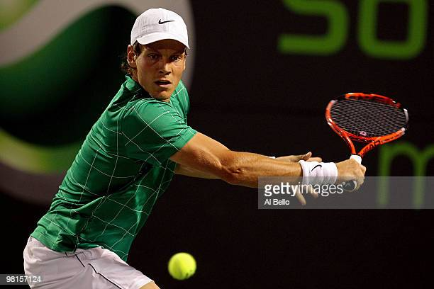 Tomas Berdych of the Czech Republic returns a shot against Roger Federer of Switzerland during day eight of the 2010 Sony Ericsson Open at Crandon...