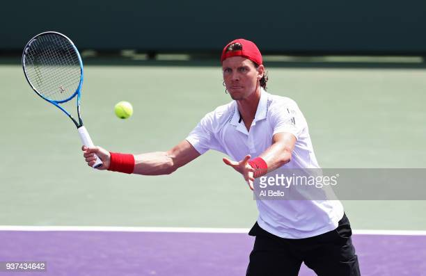 Tomas Berdych of the Czech Republic returns a shot against Yoshishito Nishioka of Japan during Day 6 of the Miami Open at the Crandon Park Tennis...