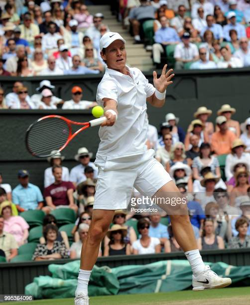 Tomas Berdych of the Czech Republic returns the ball against Roger Federer of Switzerland in the Mens Singles Quarter Final on day nine of the 2010...