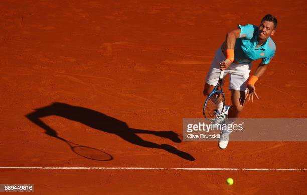 Tomas Berdych of the Czech Republic serves against Andrey Kuznetsov of Russia in their first round match on day two of the Monte Carlo Rolex Masters...