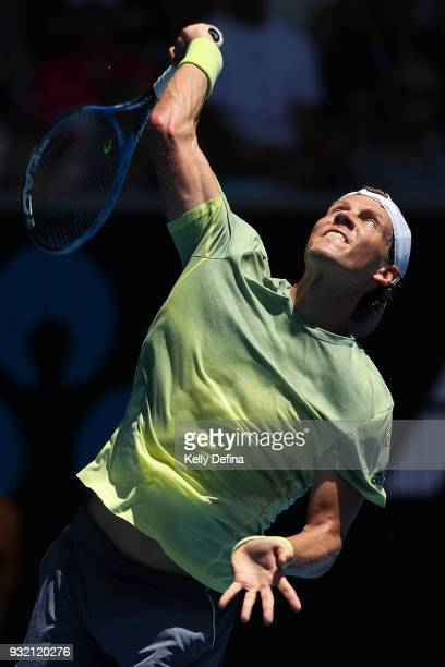 Tomas Berdych of the Czech Republic serves in his fourth round match against Fabio Fognini of Italy on day eight of the 2018 Australian Open at...