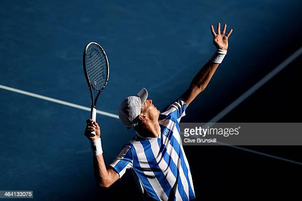 Tomas Berdych of the Czech Republic serves in his quarterfinal match against David Ferrer of Spain during day nine of the 2014 Australian Open at...