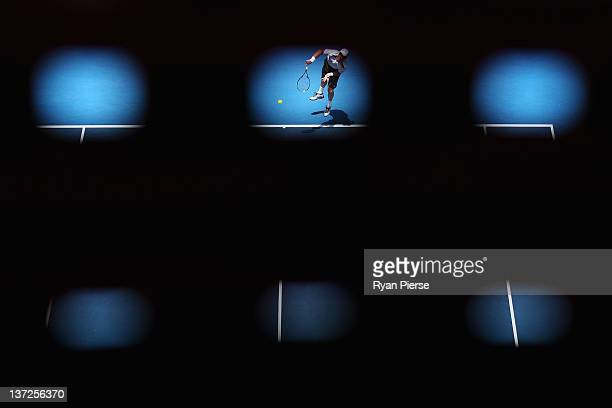Tomas Berdych of the Czech Republic serves in his second round match against Olivier Rochus of Belgium during day three of the 2012 Australian Open...