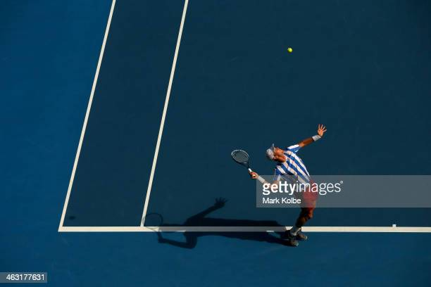 Tomas Berdych of the Czech Republic serves in his third round match against Damir Dzumhur of Bosnia and Herzegovina during day five of the 2014...