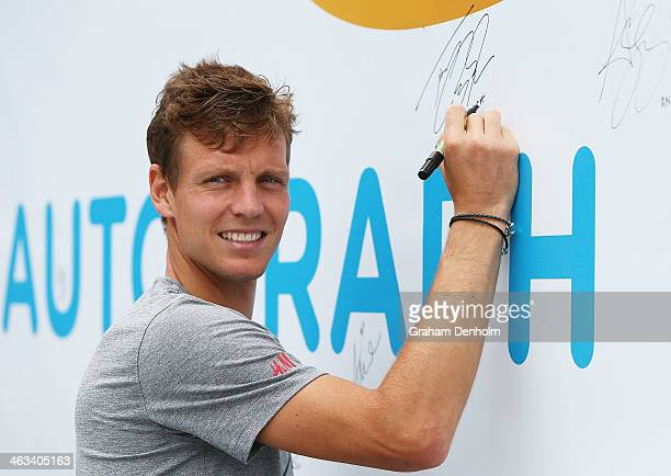 Tomas Berdych of the Czech Republic signs his autograph at the MLC Autograph Island during day 6 of the 2014 Australian Open at Melbourne Park on...