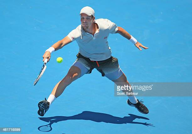 Tomas Berdych of the Czech Republic stretches for the ball during his match against Kei Nishikori of Japan during day four of the AAMI Classic at...