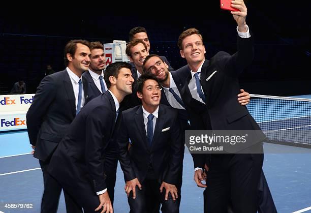 Tomas Berdych of the Czech Republic takes a group selfie of Stan Wawrinka of Switzerland,Milos Raonic of Canada,Novak Djokovic of Serbia,Kei...