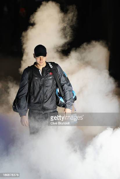 Tomas Berdych of the Czech Republic walks out for his men's singles match against Stanislas Wawrinka of Switzerland during day one of the Barclays...