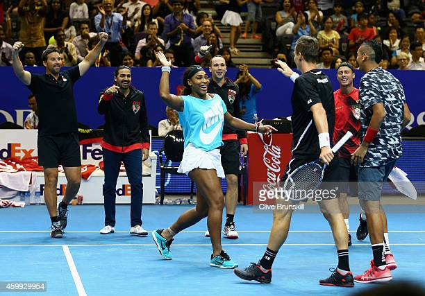 Tomas Berdych of the Singapore Slammers is congratulated by team mate Serena Williams on his victory against Marin Cilic of the UAE Royals during the...