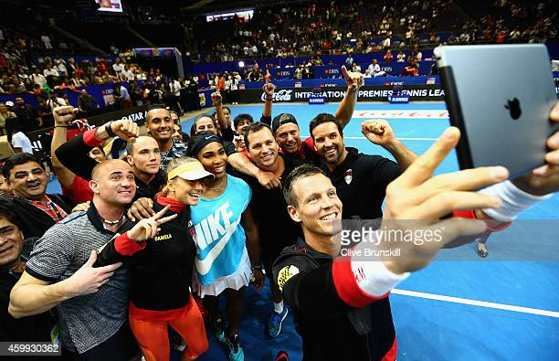 Tomas Berdych of the Singapore Slammers takes a team selfie after their victory against the UAE Royals during the Coca-Cola International Premier...