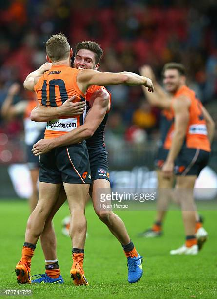 Tomas Bugg and Devon Smith of the Giants celebrate on the siren during the round six AFL match between the Greater Western Giants and the Hawthorn...
