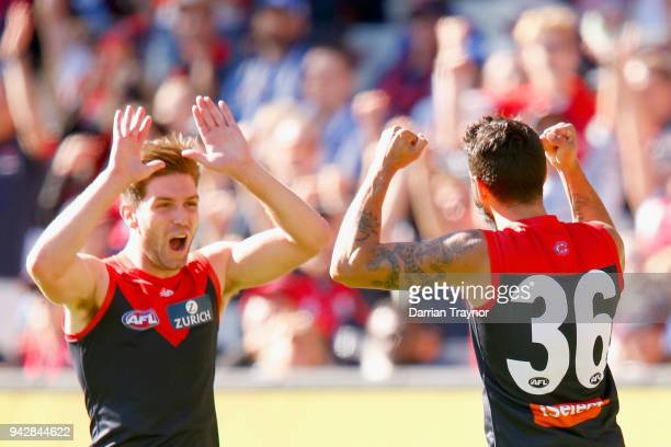Tomas Bugg and Jeff Garlett of the Demons celebrate a goal during the round three AFL match between the Melbourne Demons and the North Melbourne...