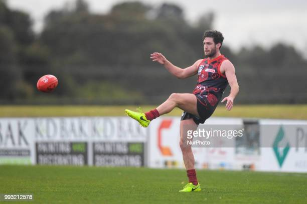 Tomas Bugg of the Casey Demons kicks the ball during the VFL round 14 game between the Casey Demons and North Melbourne at Casey Fields in Melbourne...